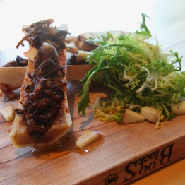 Roasted Bone Marrow with Braised Oxtail and Frisee Apple Salad - Photo by Beth Clauss