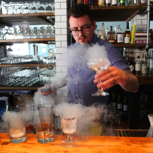 Ben Bauer chills down glasses with liquid nitrogen - Photo by Beth Clauss